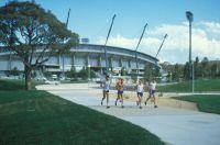 Robert de Castella 1982 Athletics training group outside outdoor stadium