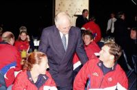 Prime Minister John Howard chatting with the AIS Commonwealth Games team at a farewell breakfast 2002