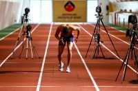 Athlete Robbie Crowther on the indoor running track 2009