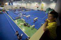 AIS Gymnasium hall, kids watching on as athletes train 2013