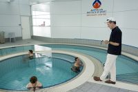 Dr. David Martin physiologist, timing the amount of time spent in the plunge pool by the athletes 2007