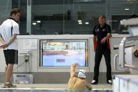 Coach John Fowlie uses the poolside monitors to help coach his athletes 2009