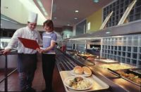 Nikki Cummings and chef at the AIS dining hall 1999