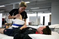 Physical therapies physiotherapist Ebonie Scase treating AIS athlete Heath Francis 2009