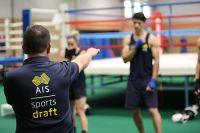 Boxing coach Don Abnett demonstrating punch technique AIS sports draft athletes 2014