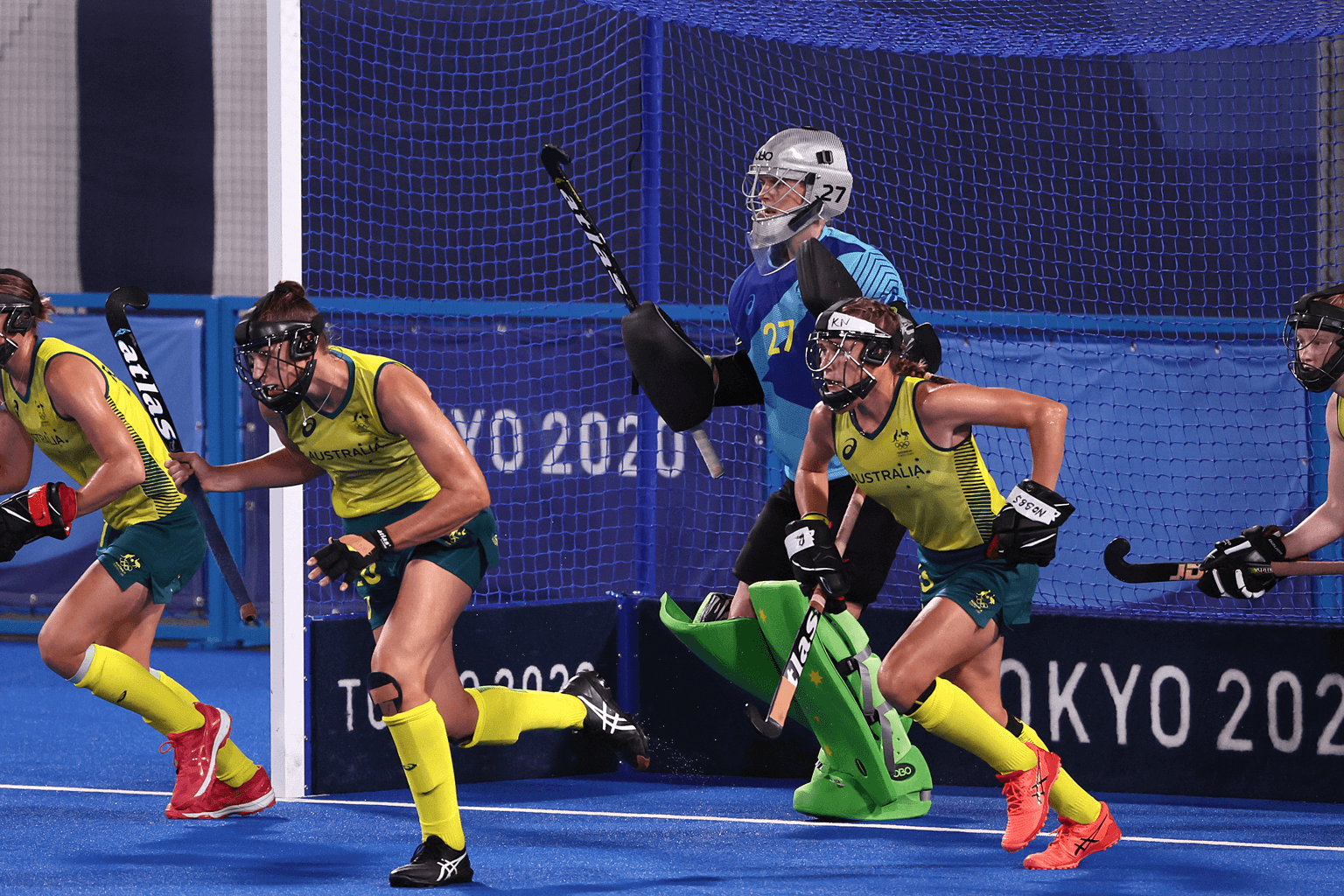 Members of the Hockeyroos Australian women's hockey team run out of goal, with keeper Rachael Lynch in blue protective clothing. Photo: Getty Images