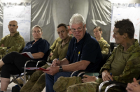 AIS' Peter Day speaks with Australian Army personnel and AIS representatives.